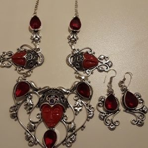 Jewelry - Red and Ruby gemstone carved face necklace